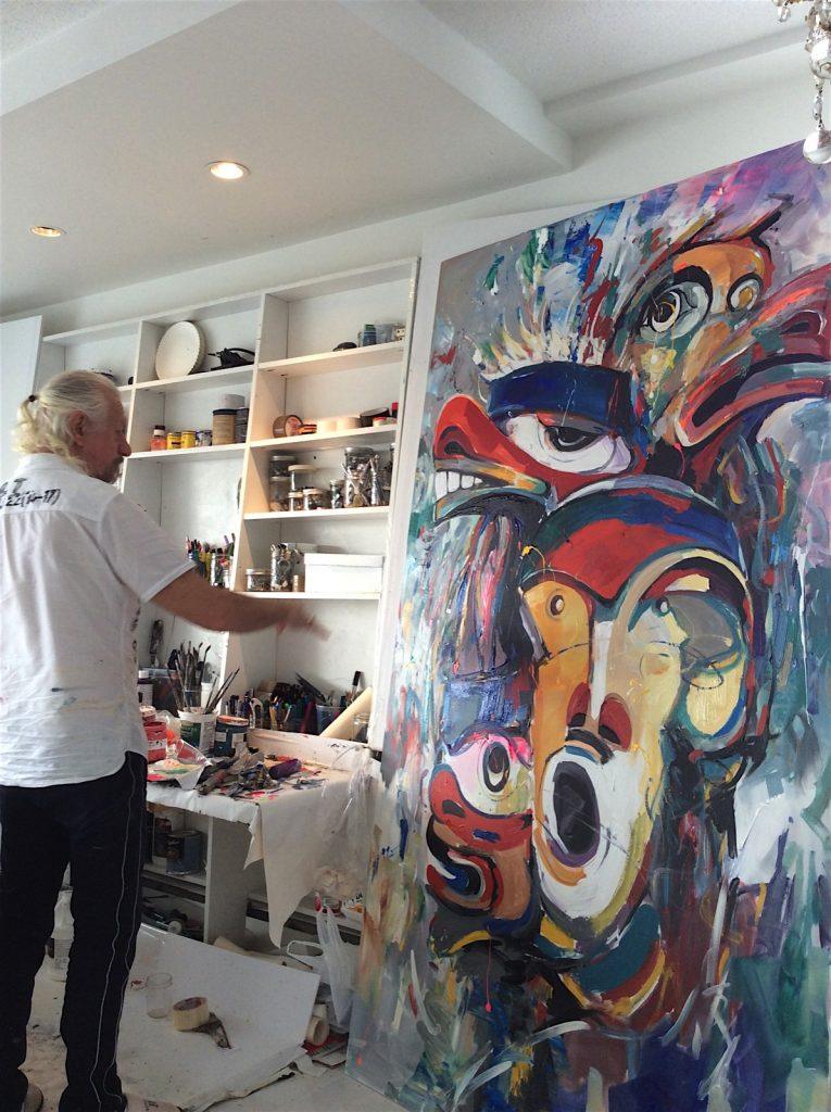 artist-painting-in-studio-765x1024