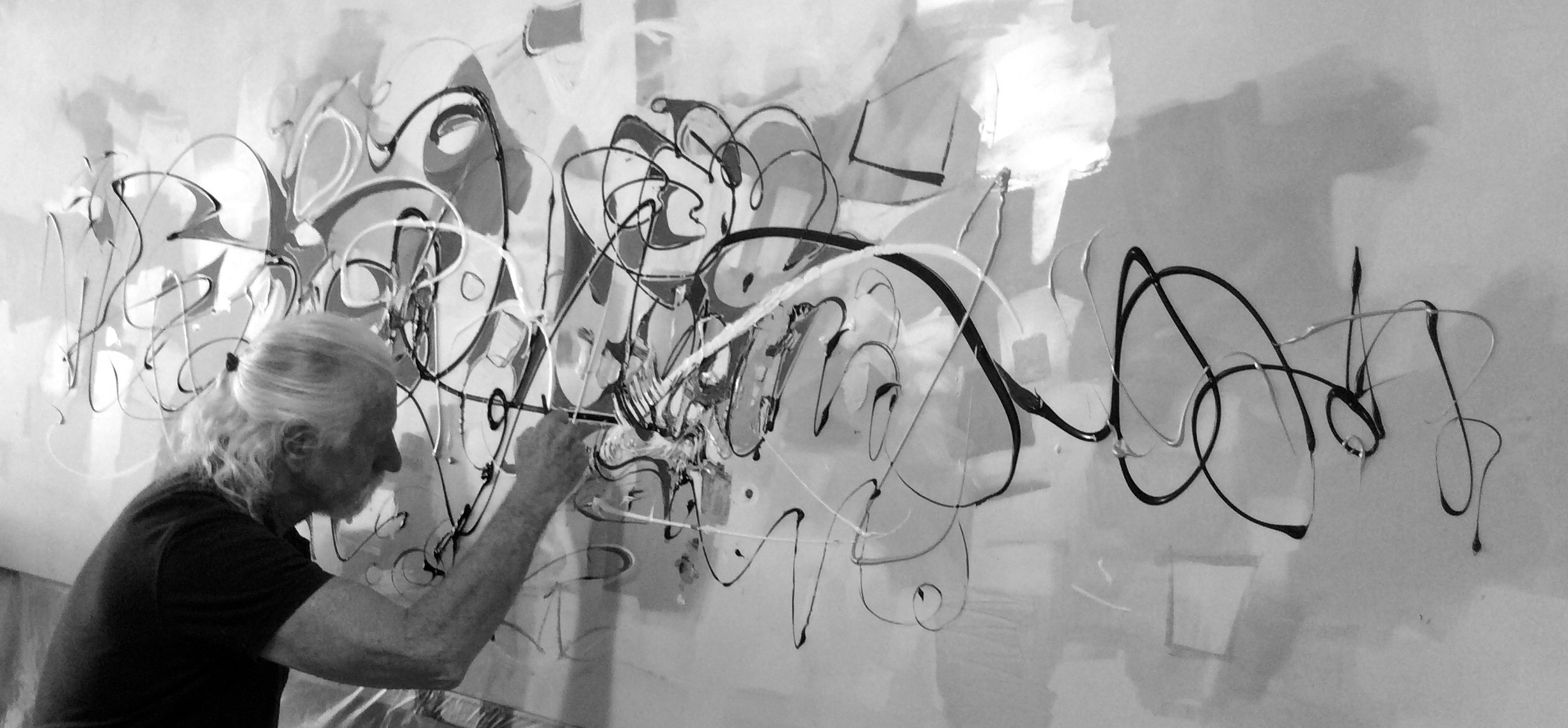Artist Paul Ygartua painting in studio